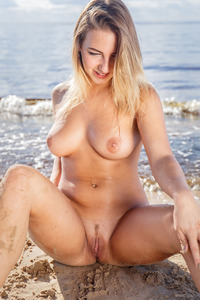 Busty Blonde Angelica B Strips On The Beach