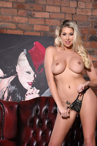 Lexi Lowe Posing On A Leather Couch