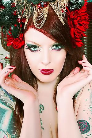 Evil tattooed redhead doing...