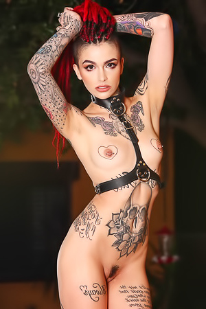 Tattooed Girl In Black Latex Dress