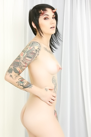 Sexy Tattooed Girl Gets Naked