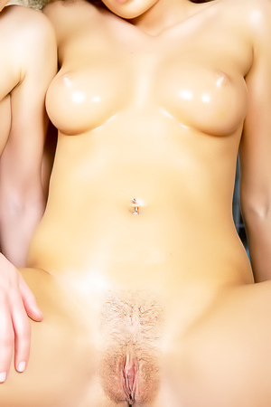Two hot girls oil each other up and play