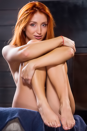 Sexy Ukrainian redhead Michelle H looks hot in every sense of the word
