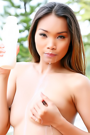 Zara Lang Asian Model With Milk On Lips