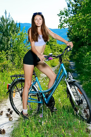 Rosella During her bike ride, she pulls off the trail and gets naked